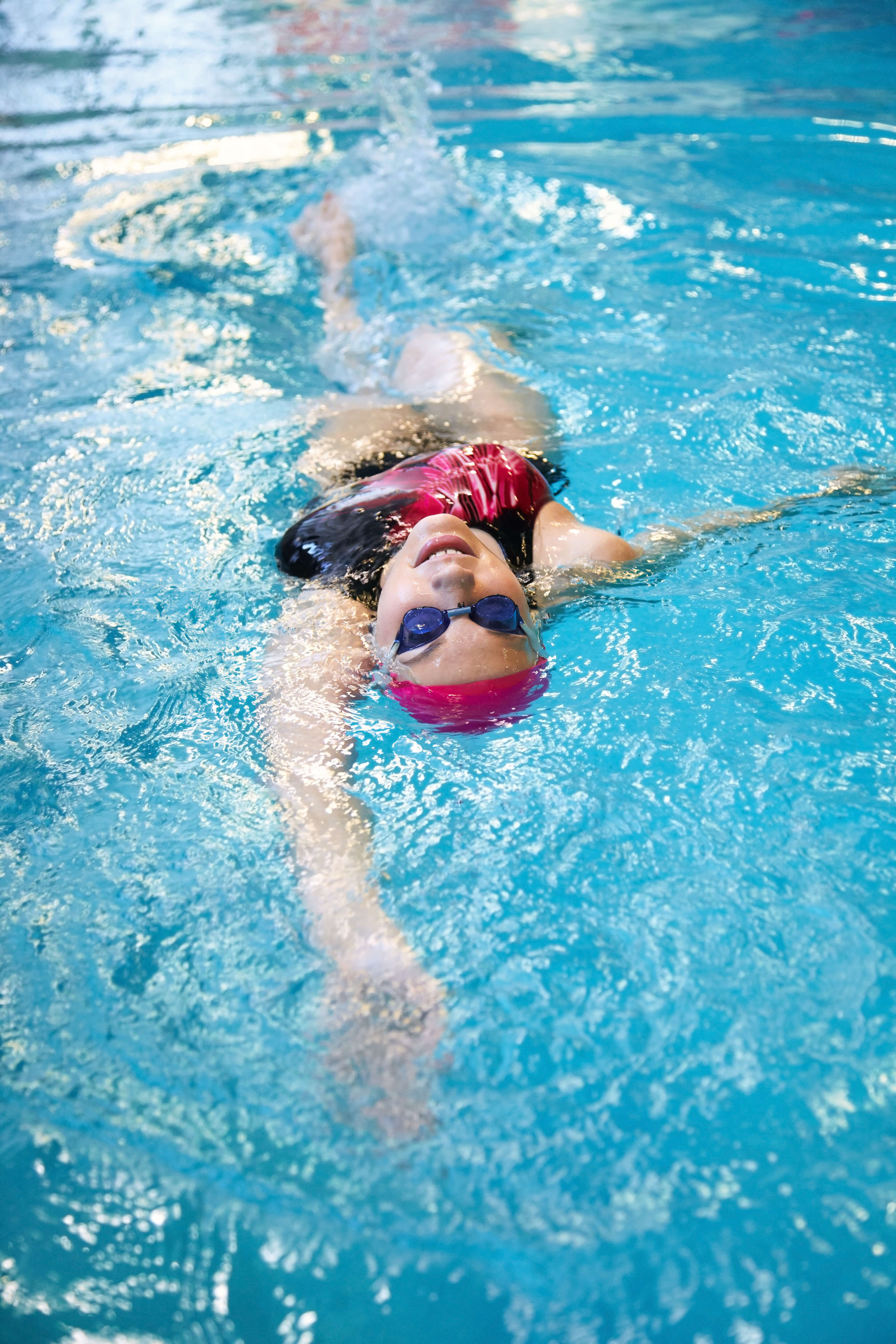 Adult Swimming Lessons. Woman taking part in a swim school in hertfordshire